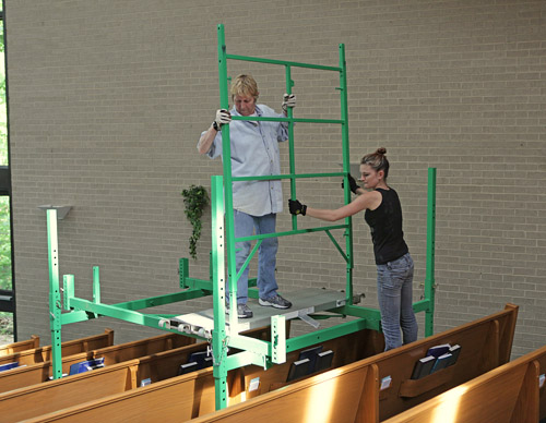 Light bulb changing scaffolding for churches